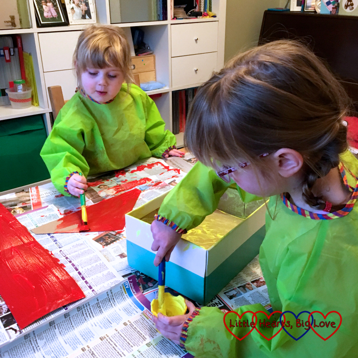 Jessica and Sophie painting the shoebox and roof pieces
