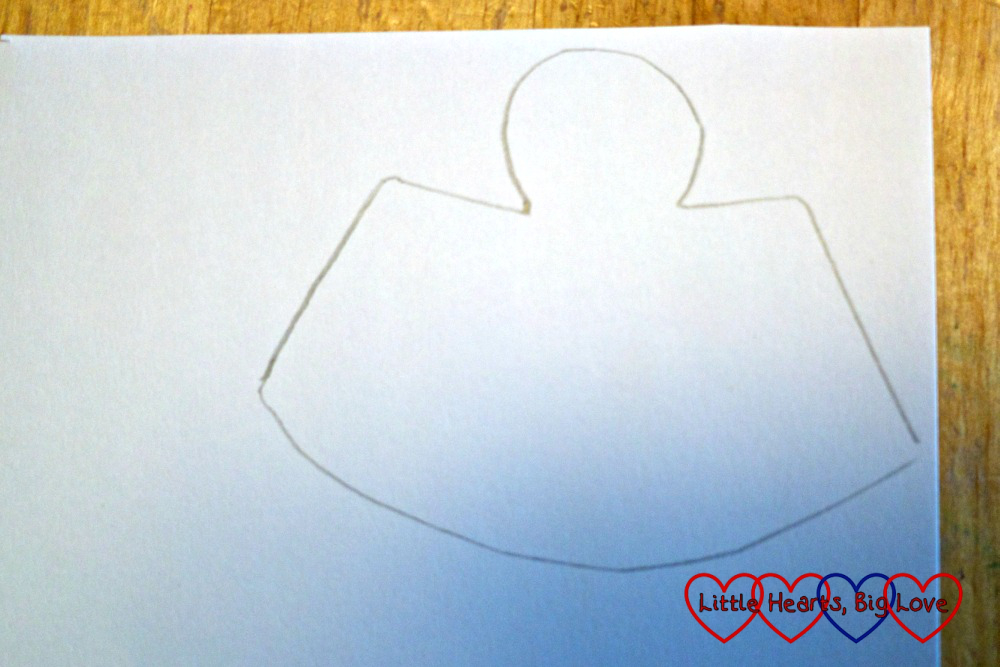 "An ""angel"" shape drawn on a piece of paper"