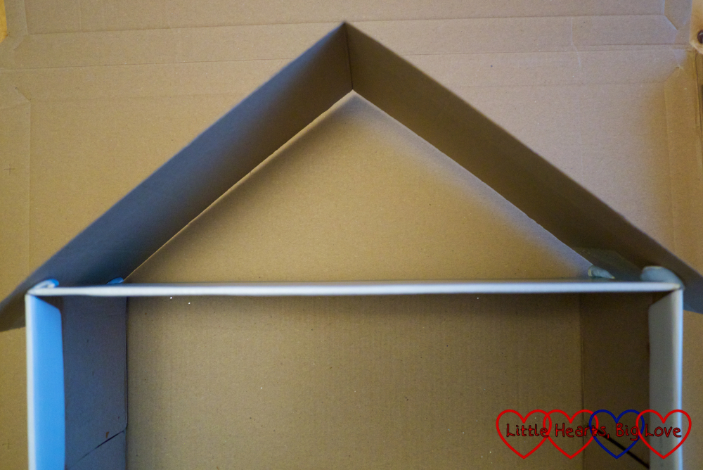 The roof placed on top of the shoebox ready to draw around the cardboard
