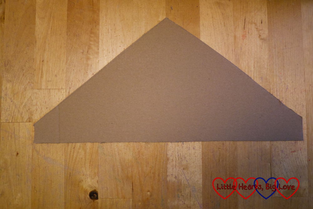 The cut out piece of cardboard for the attic wall