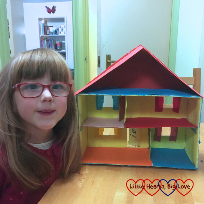 Jessica with the completed shoebox house