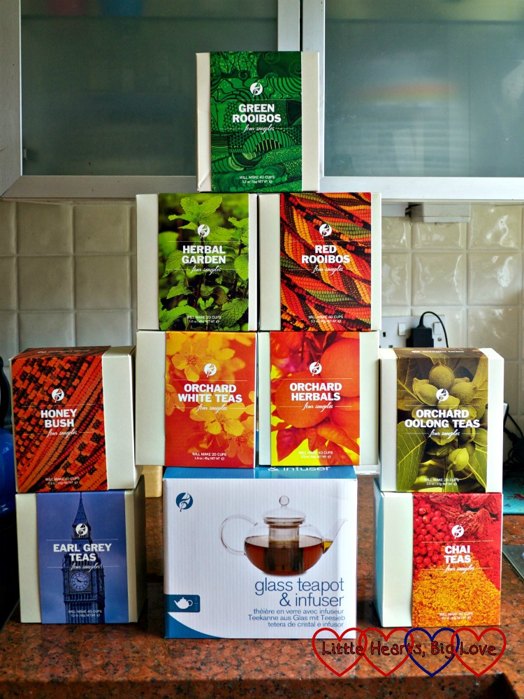 A selection of Adagio Teas - Green Rooibos, Herbal Garden, Red Rooibos, Honeybush, Orchard White Teas, Orchard Herbals, Orchard Oolong Teas, Earl Grey Teas and Chai Teas plus a glass teapot