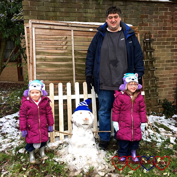 Jessica, Sophie and Daddy with the snowman