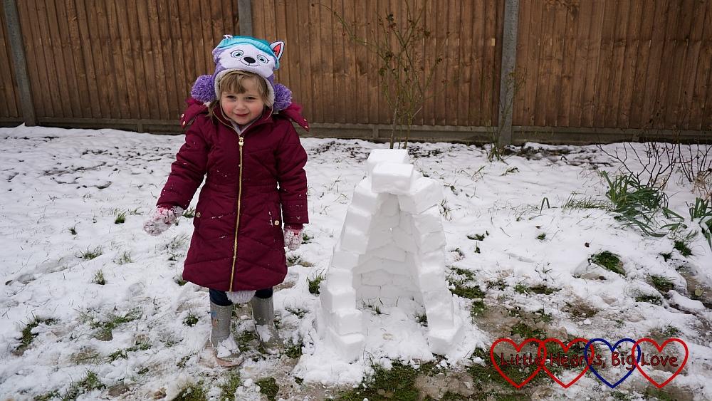Fun in the snow: building a mini-igloo