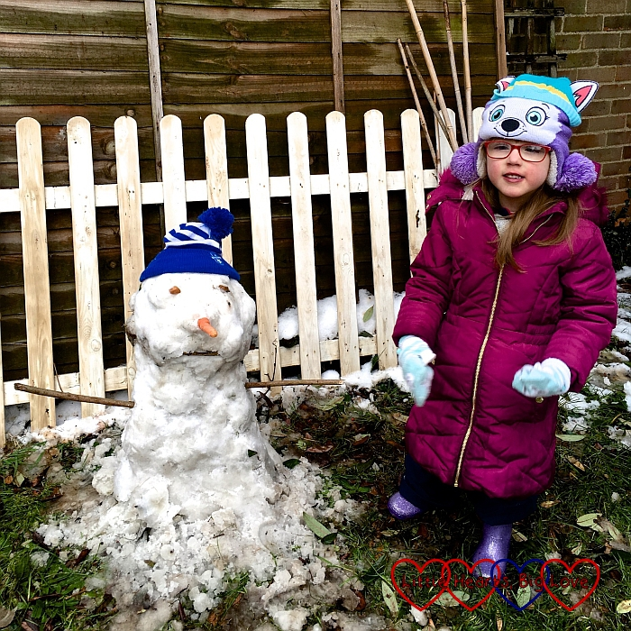 Jessica with the snowman we made