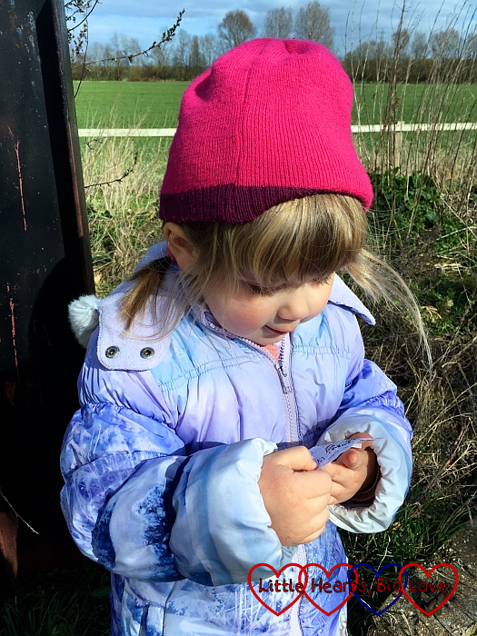 Sophie investigating the log from a geocache