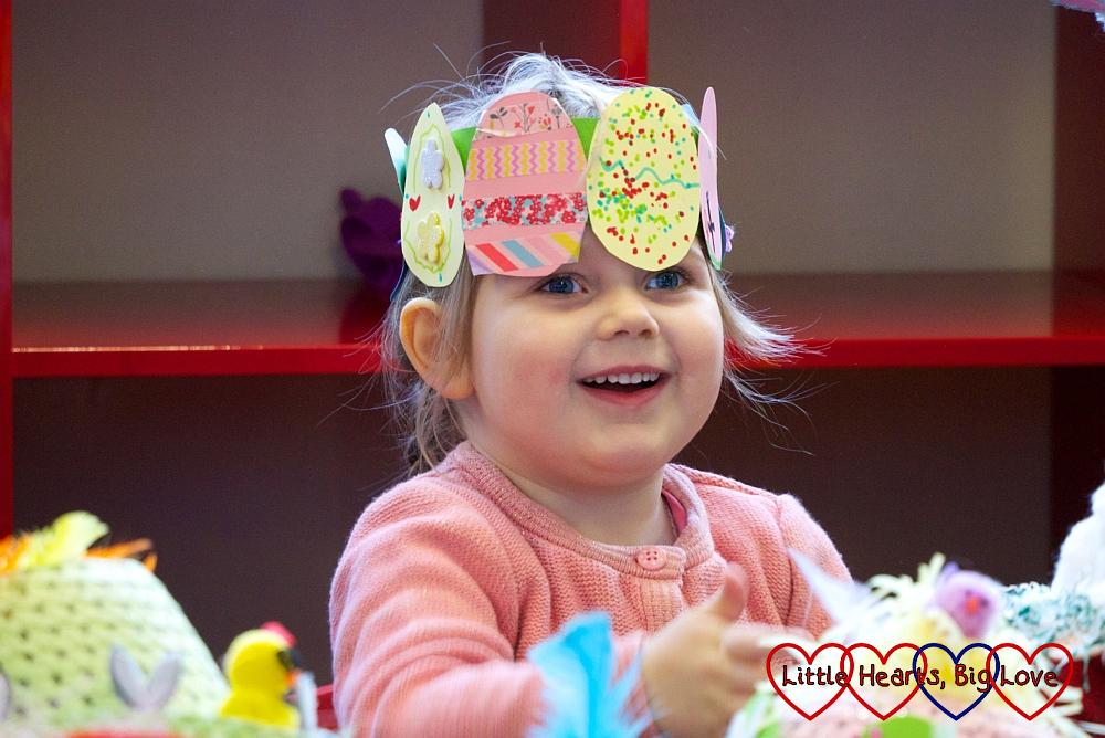 Sophie wearing her Easter egg crown in her preschool Easter concert