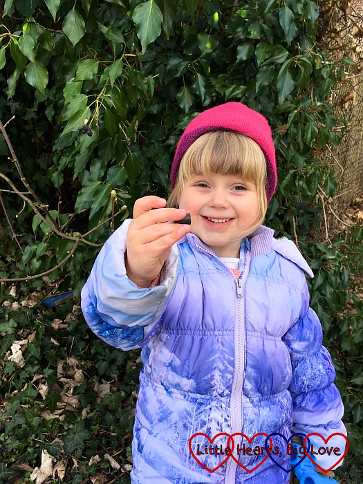 Sophie holding up a geocache