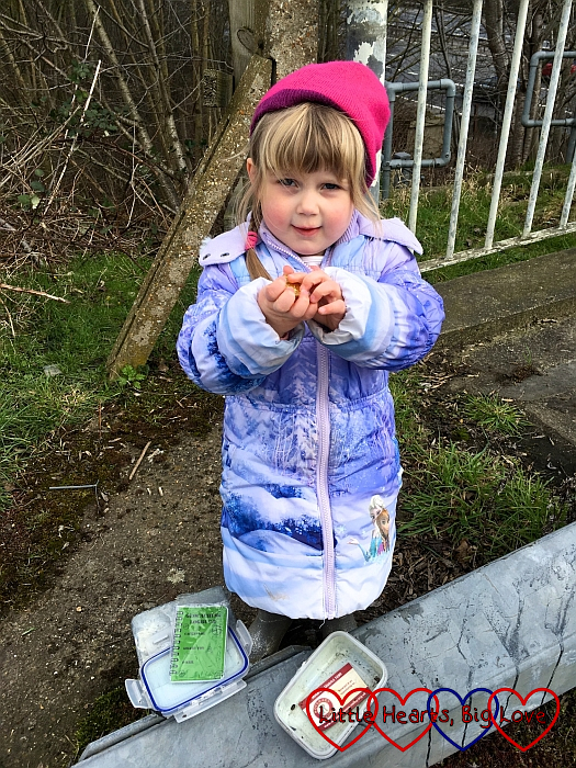 "Sophie finding ""treasure"" in one of the geocaches"