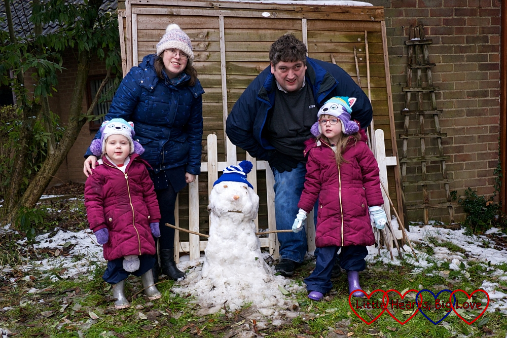 Me, hubby, Jessica and Sophie with our snowman in the garden