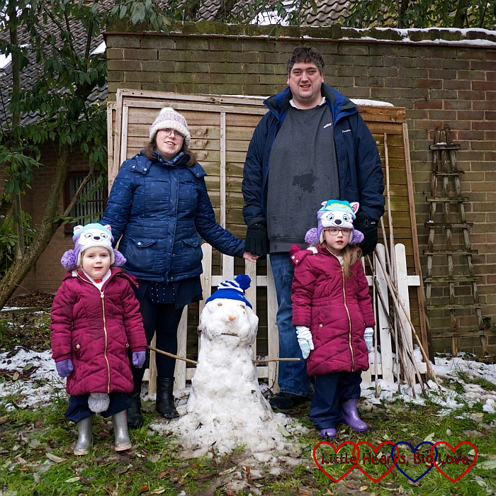 Me, hubby, Jessica and Sophie in the garden with our snowman