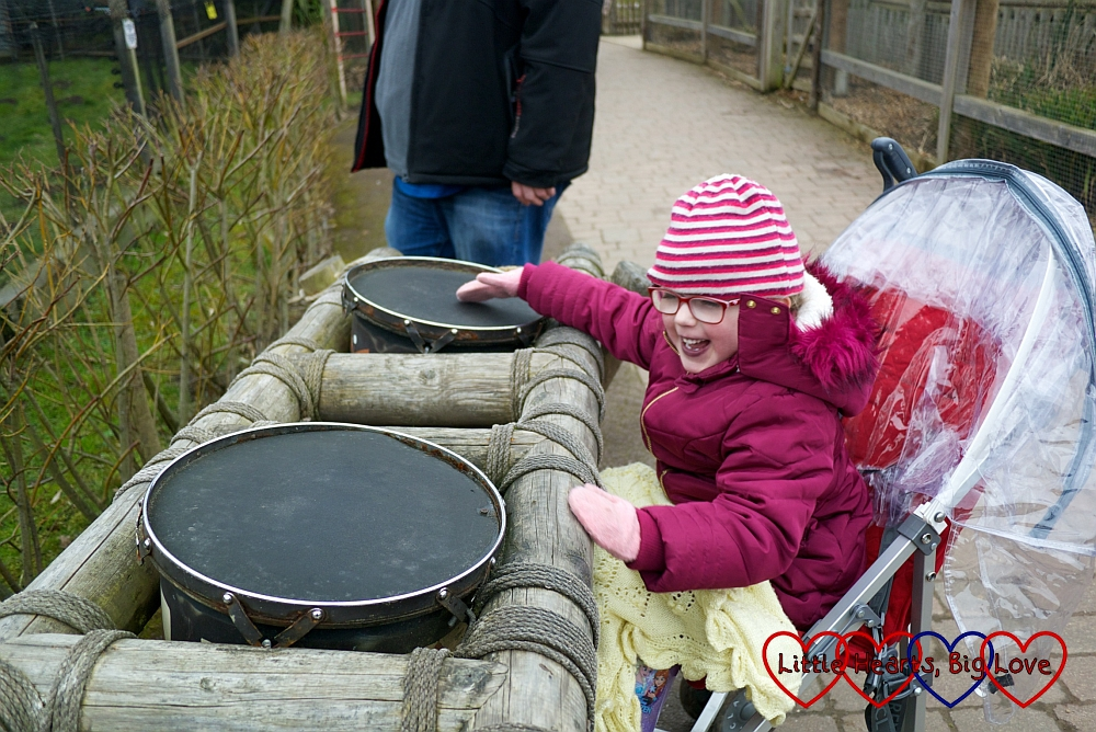 Jessica playing the African drums in the Wanyama Village and Reserve