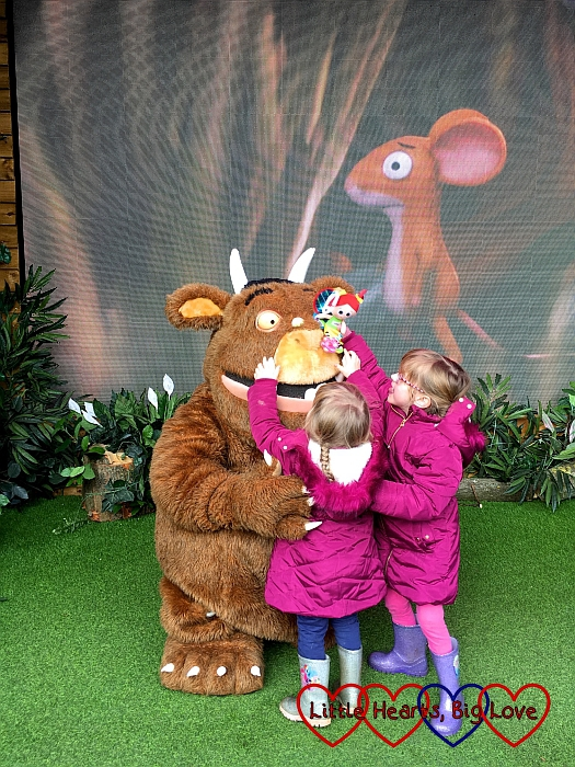 Jessica and Sophie having a cuddle with the Gruffalo