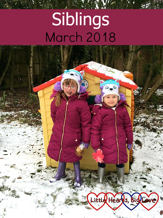 "Jessica and Sophie standing in front of their playhouse in the snow - ""Siblings - March 2018"""