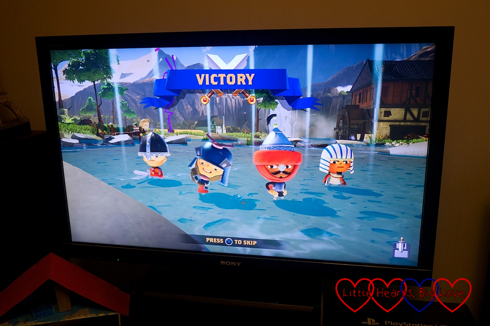 A screenshot from World of Warriors with victory for the player's two warriors in battle mode