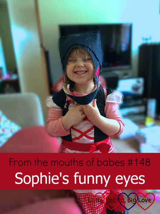 "Sophie pulling a funny face and wearing a canvas bag for a hat - ""From the mouths of babes #148 - Sophie's funny eyes"""