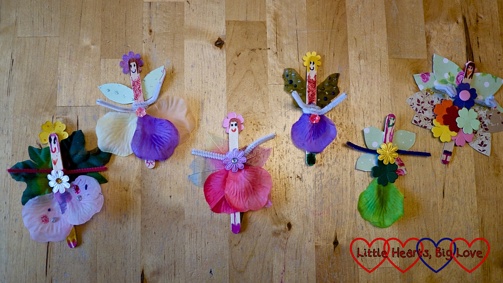 An assortment of craft stick flower fairies