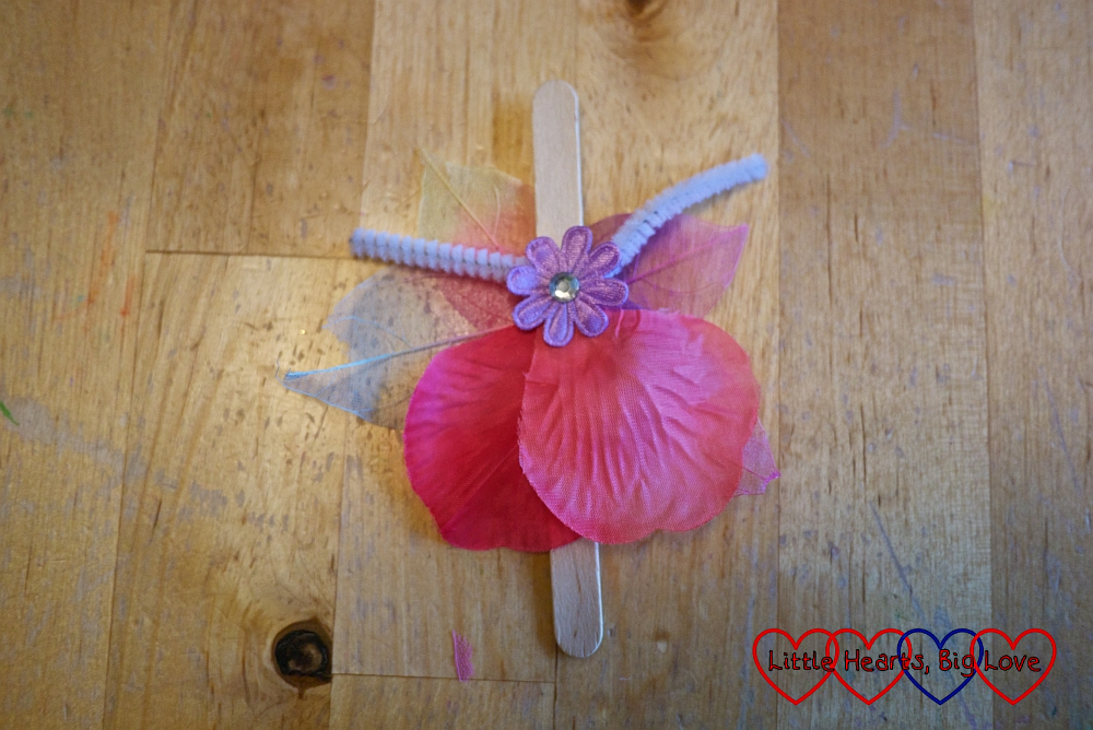 The craft stick with petal and flower shapes added for the fairy's dress