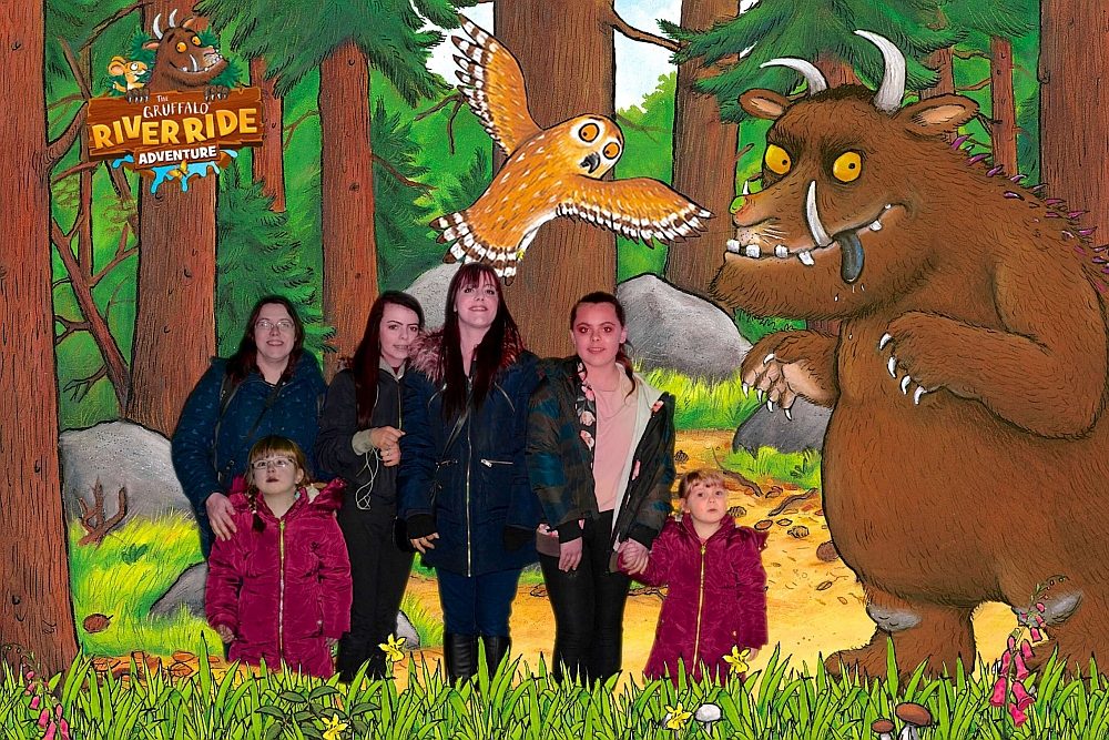 Me, my sister, Jessica, Sophie and their cousins Ebony and Erin posing against a Gruffalo-themed background