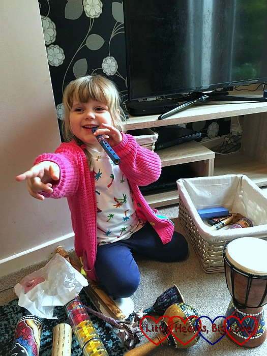 Sophie playing with instruments