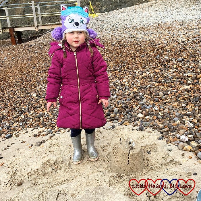 Sophie with the sandcastle she built at Alum Bay