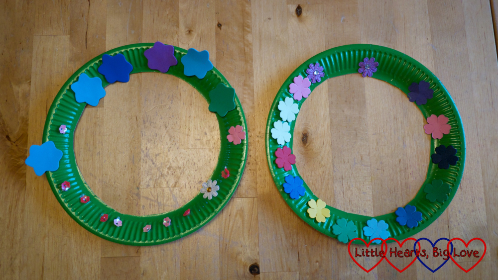 Two paper plate flower wreaths