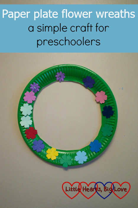 "A paper plate flower wreath hanging on a door - ""Paper plate flower wreaths - a simple craft for preschoolers"""