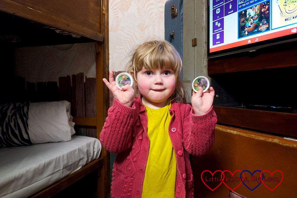 Sophie with the two pop badges she found in the safe