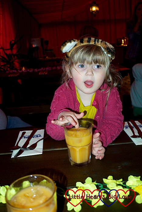 Sophie enjoying a children's cocktail in the Explorer's Outpost restaurant