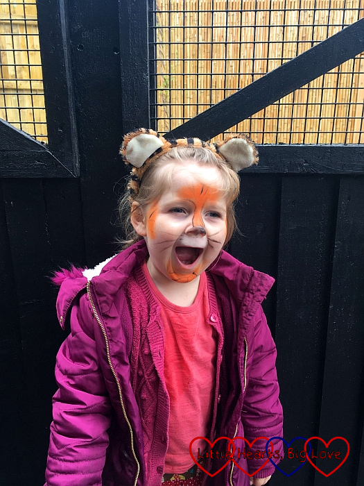 Sophie with her face painted like a tiger