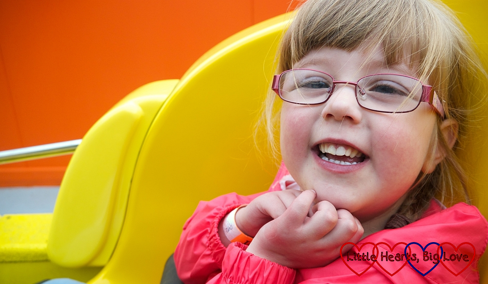 A smiley Jessica on a fairground ride