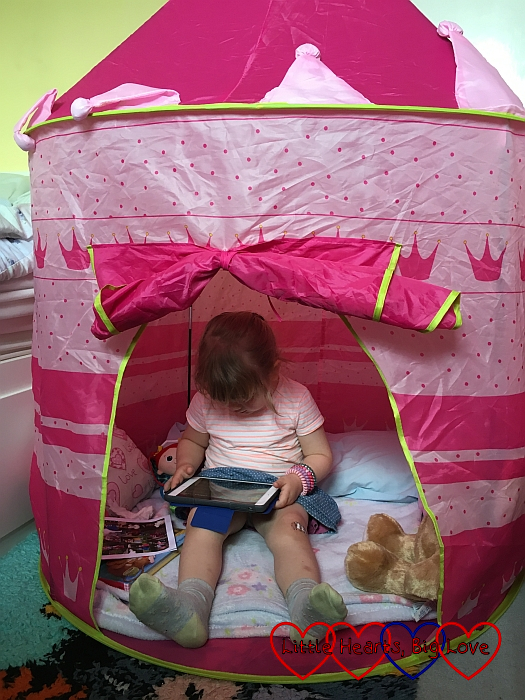 Sophie in the safe space of her princess tent