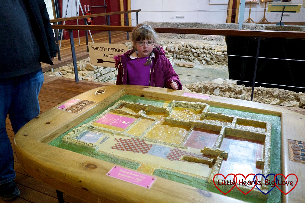 Jessica looking at the model of Brading Roman Villa