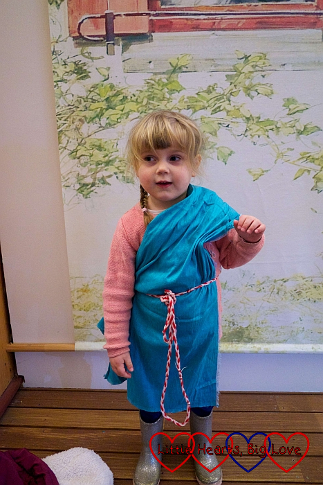 Sophie wearing a turquoise toga