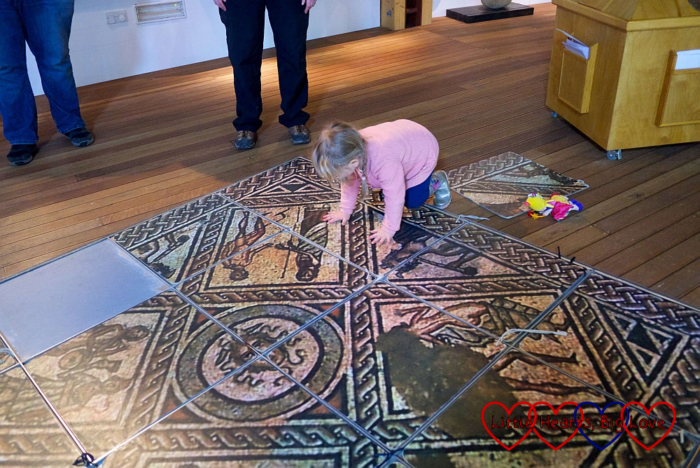 Sophie putting together the pieces of the mosaic jigsaw puzzle