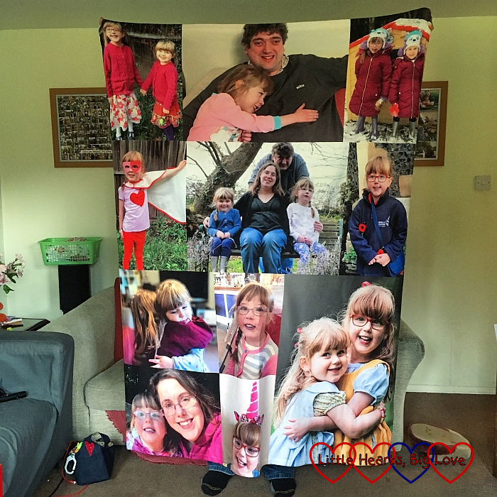Hubby holding up a blanket covered in photos of us with Jessica