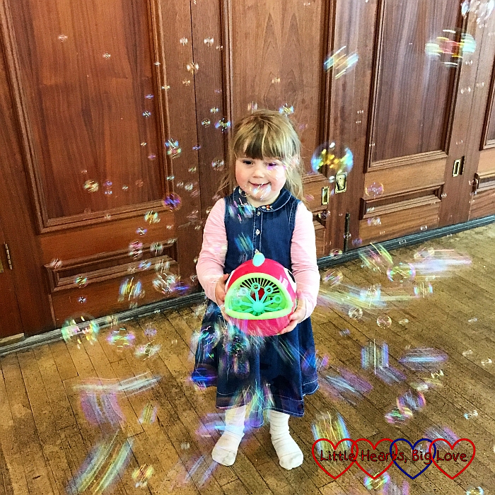 Sophie holding the bubble machine at Tiny Talk