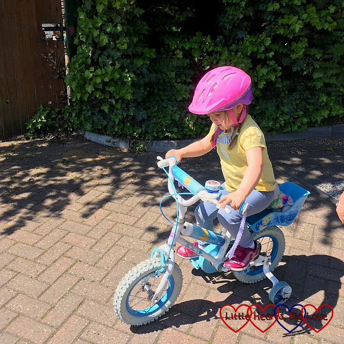 Sophie riding her bike to the park