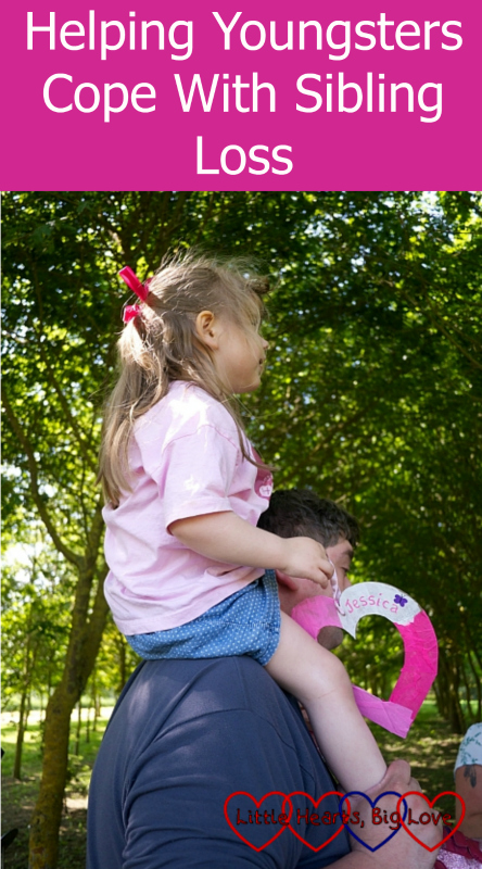 "Sophie on Daddy's shoulders getting ready to hang Jessica's heart on the memorial tree - ""Helping youngsters cope with sibling loss"""