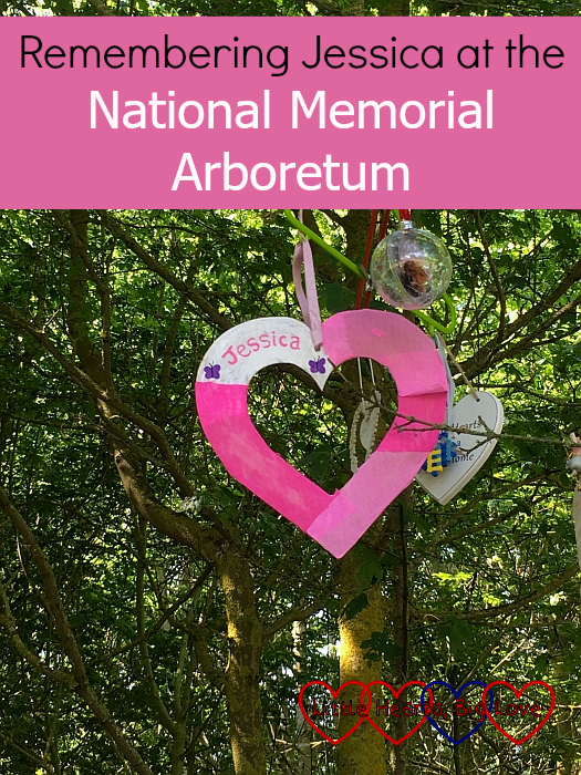 "A pink heart with ""Jessica"" written on it hanging on the Little Hearts Matter tree in the National Memorial Arboretum - ""Remembering Jessica at the National Memorial Arboretum"""