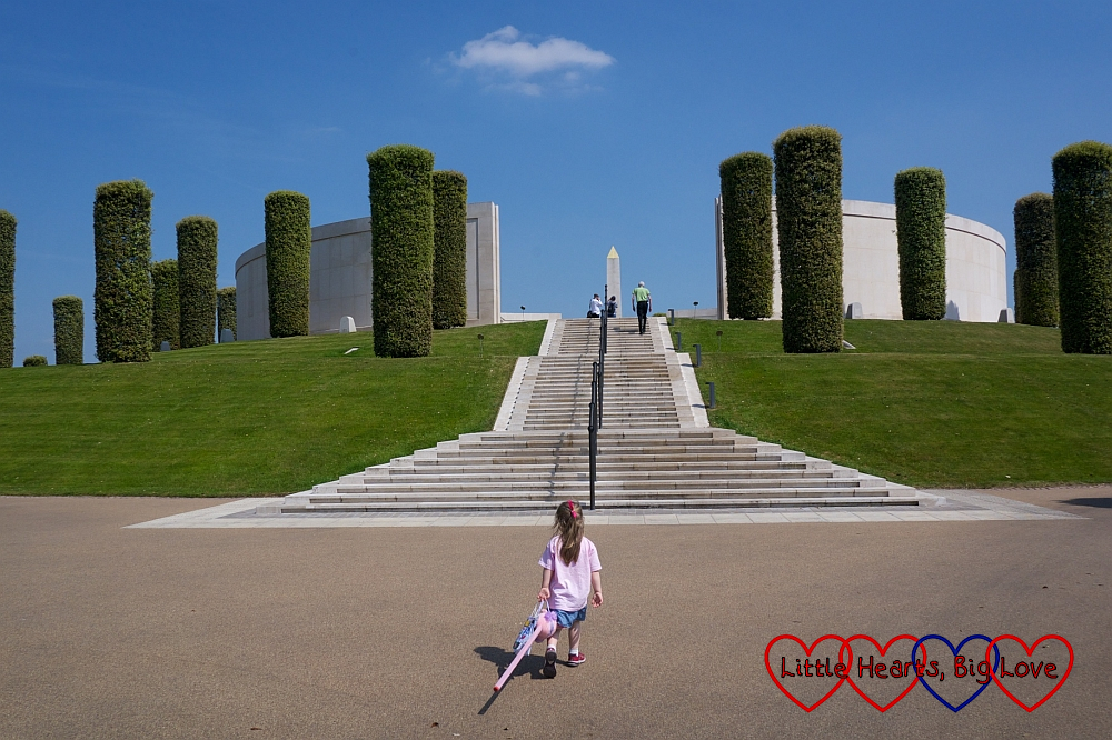 Sophie standing by the steps leading up to the Armed Services memorial