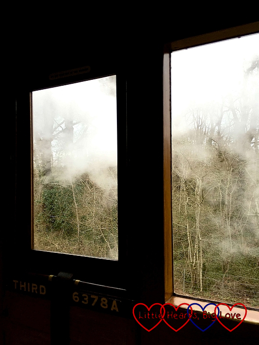 Steam going past the window of the train carriage