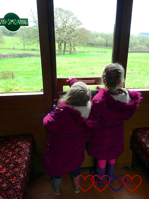 Jessica and Sophie looking out of the window on the train