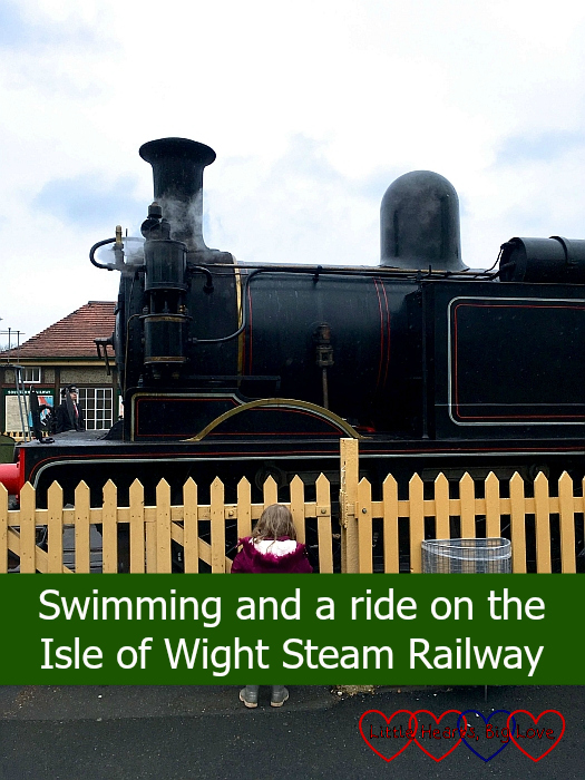 "Sophie watching one of the steam trains on the Isle of Wight steam railway - ""Swimming and a ride on the Isle of Wight steam railway"""