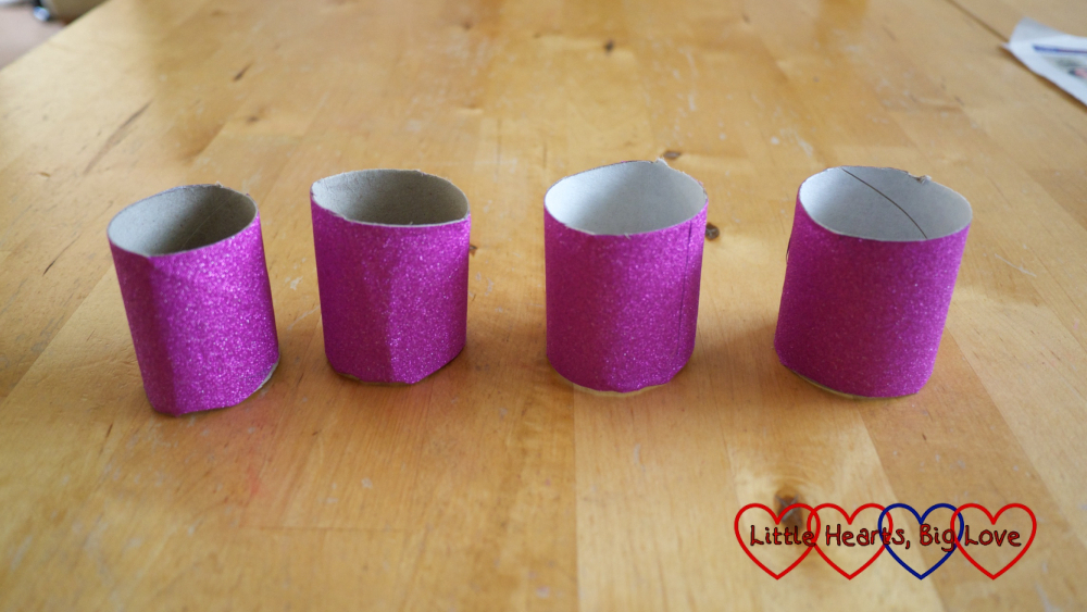 The toilet roll tubes covered in purple sparkly paper