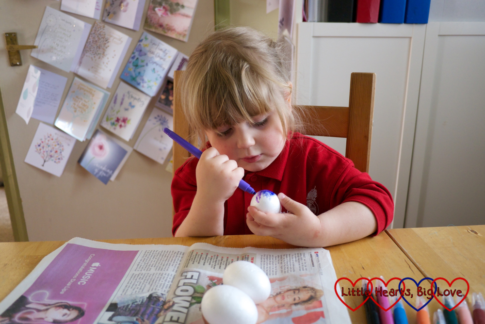 Sophie painting the polystyrene eggs