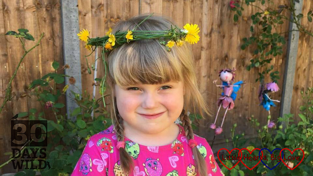 Sophie wearing a flower crown made from hawksbeard