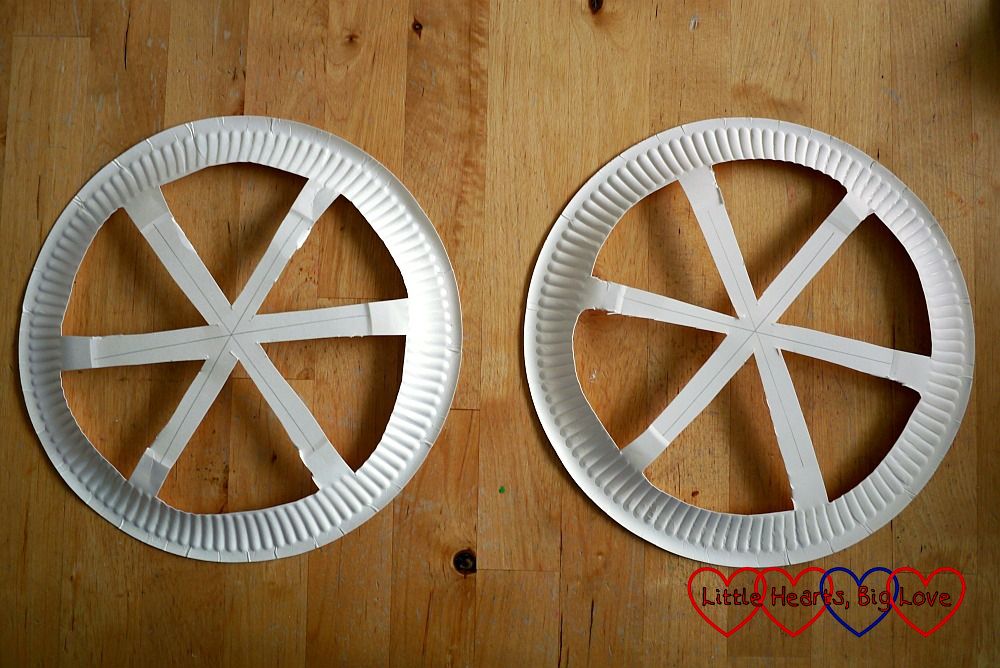 Two paper plates with six cut out segments