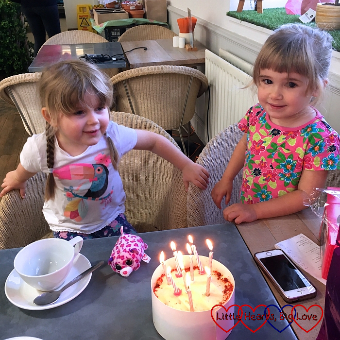 Sophie and her friend waiting for me to blow the candles out on my birthday cake