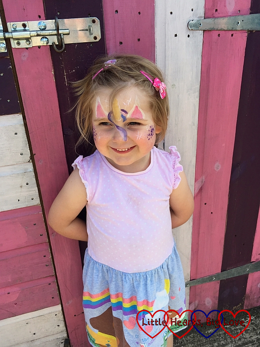 Sophie with her face painted as a unicorn at the school summer fayre